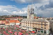 ZAGREB, CROATIA - September 16, 2014: Aerial view of Dolac market covered with parasols and fresh fruit and vegetables in Zagreb, Croatia. It has been the city's major trading place since 1926.