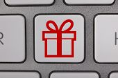 stock photo of telecommuting  - Gift Symbols on Keyboard Telecommuting Shipping Holiday Office - JPG