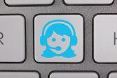 Service on Keyboard Blue Woman