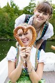 Two Woman With Pretzel