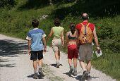 Family walking mountain path
