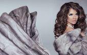 image of mink  - Beautiful brunette woman in mink fur coat - JPG