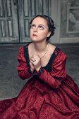 Beautiful Medieval Woman In Red Dress Praying