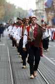 ZAGREB, CROATIA - OCTOBER 04: The parade of 70 participants, thirty horses and forty members of a brass band to the main square were announced next, 300th Sinjska Alka, on October 04, 2014 in Zagreb.