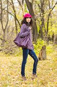 Young Stylish Woman With A Big Bag In The Autumn Park