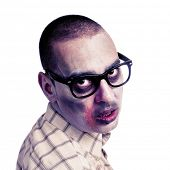 portrait of a hipster zombie with black plastic-rimmed eyeglasses against a white background