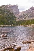 Dramatic Peak Over An Alpine Lake