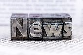 the word news written with lead letters. symbol photo for newsletters, newspapers and information