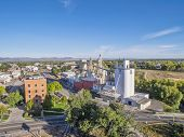 FORT COLLINS, CO, USA - October 6, 2014: Aerial view of Fort Collins landmarks - historic Harmony Mill and Ranchway Feed grain elevator.