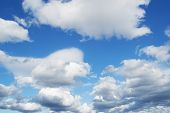 foto of stratus  - fluffy white clouds in the blue sky - JPG
