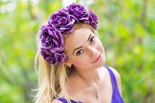 Beauty portrait of young pretty girl with flower wreath in her hair