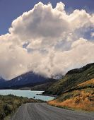 National Park in Chilean Patagonia - Torres del Paine. Gravel road bends along the shores of Lake Pehoe