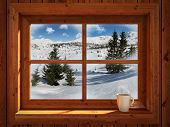 image of chalet  - Idyllic and peacefull winter landscape of snowy mountains view through rustic cabin window - JPG