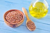 picture of flax seed oil  - flax seed in bowl and on a table - JPG