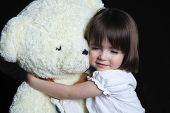 pic of girlie  - a little girl with bear on a black background - JPG