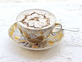 Cappuccino with an ornament in a cup