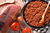 Bolognese Sauce In Skillet With Ingredients Horizontal Top View
