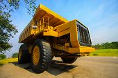 stock photo of dump_truck  - Heavy mining truck in mine and driving along the opencast - JPG