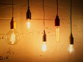 pic of concrete  - Light bulbs decorating a concrete wall - JPG