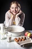 Smiling Homemaker In Kitchen