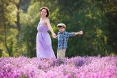 Young woman and her little son in lavender field