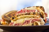 stock photo of deli  - Famous New York Reuben corned beef sandwich with chips and a pickle - JPG