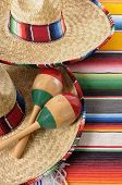 Mexican Sombreros With Maracas And Traditional Serape Blankets.
