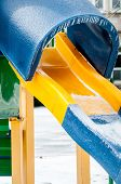 Snow And Ice Covered Playground