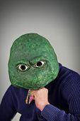 picture of unnatural  - Creepy bald lizard man wearing a blue sweater - JPG