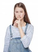 Young Fashion Girl With Finger On Lips Isolated