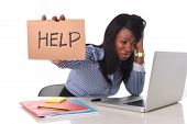 picture of black american  - black African American ethnicity tired and frustrated woman working as secretary in stress at work office desk with computer laptop asking for help in business frustration concept - JPG
