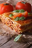 Lasagna With Basil And Tomatoes On An Old Table, Vertical Rustic