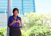 Business Woman Reading Text Message On Mobile Phone Outdoors