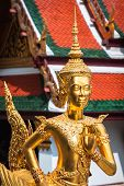 Golden Kinnari Statue At Temple Of Emerald Buddha (wat Phra Kaew) In Grand Royal Palace. Bangkok, Th