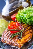 picture of  breasts  - Steak chicken breast olive oil cherry tomatoes pepper and rosemary herbs - JPG
