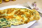 Savoury Omelette With Dill On The Plate, Fork And Garlik On The Side