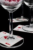 Playing Cards At The Bottom Of The Glasses