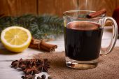 Mulled wine, punch and spices for glintwine on wooden background