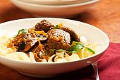 stock photo of egg noodles  - Beef stew served over large egg noodles - JPG