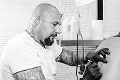 Tattooer Tattooing A Back.