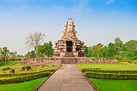 stock photo of kamasutra  - The Khajuraho Group of Monuments are a group of Hindu and Jain temples in Madhya Pradesh India - JPG