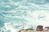 foto of cliffs moher  - Waves hitting cliff in Ireland near ocean - JPG