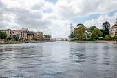 stock photo of pedestrians  - Pedestrian bridge and a small harbour in East Perth suburb Western Australia - JPG