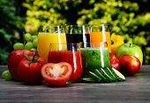 image of juices  - Glasses with fresh organic detox juices in the garden  - JPG