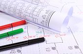 foto of drawing  - Rolls of electrical diagrams and accessories for drawing lying on construction drawings drawings and accessories for the projects engineer jobs - JPG