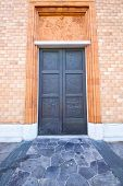 picture of windows doors  - vergiate italy church varese the old door entrance and mosaic sunny daY rose window - JPG
