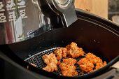 stock photo of fried chicken  - Chicken fried pop in machine for frying - JPG