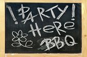 foto of bbq party  - Black Chalkboard With Wood Frame And Handwritten Sign Party Here BBQ - JPG