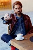 image of coffee coffee plant  - Portrait of handsome hipster man paying for his coffee with a credit card at the cafe customer paying at a coffee shop with a credit card flare sun light - JPG