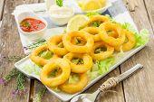 image of deep  - deep fried calamari with lemon and salad on white tray - JPG